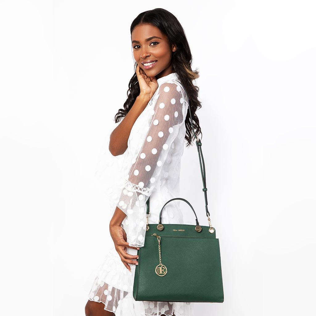 Eila Chérie Green Handbag worn by woman smiling