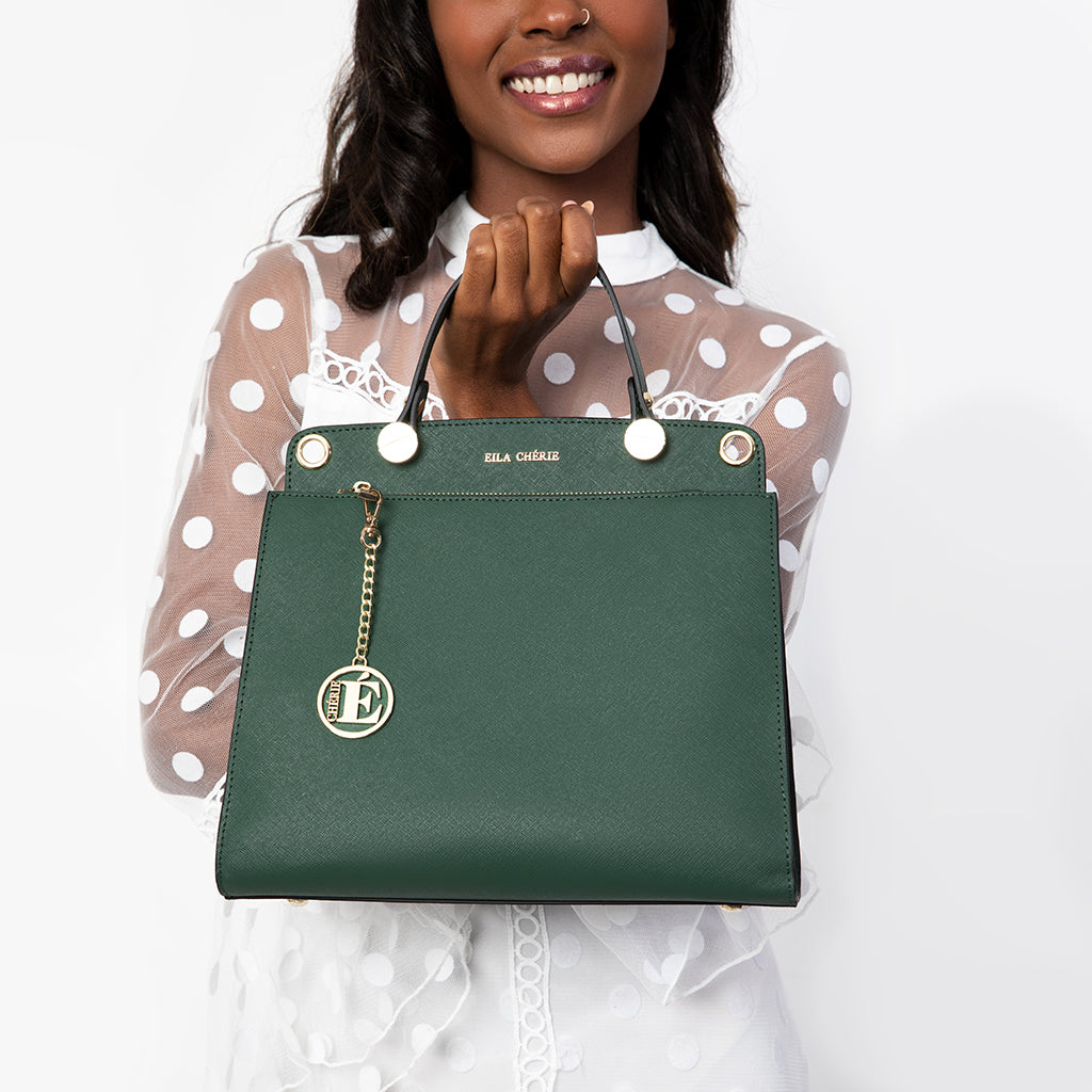 Eila Chérie Evergreen Handbag held by woman smiling