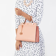 Eila Cherie Pink Leather Purse worn by woman in poca dot dress