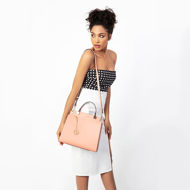 eila cherie leather audrey style handbag in the color peach on model