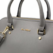 Close up of Eila Chérie gold logo on Ash Grey leather Barbara Handbag
