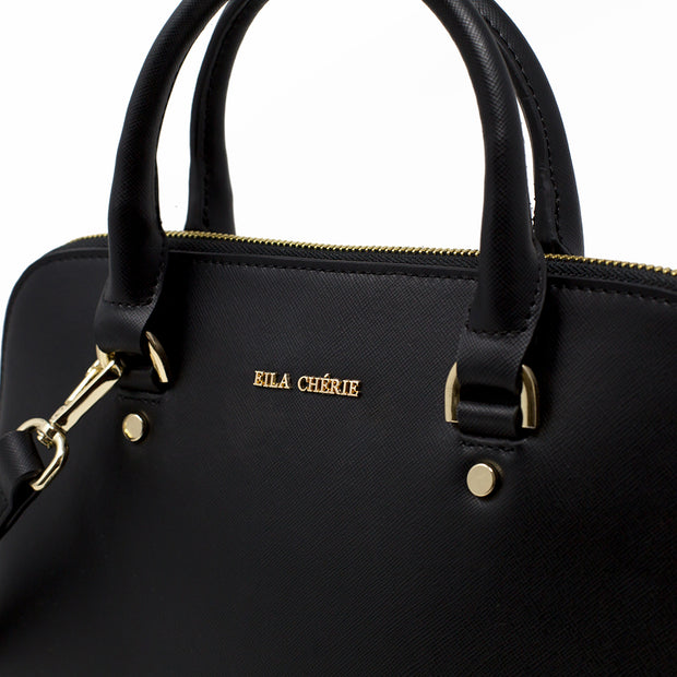 Eila Cherie close up of Barbara black leather fashion handbag with gold  logo