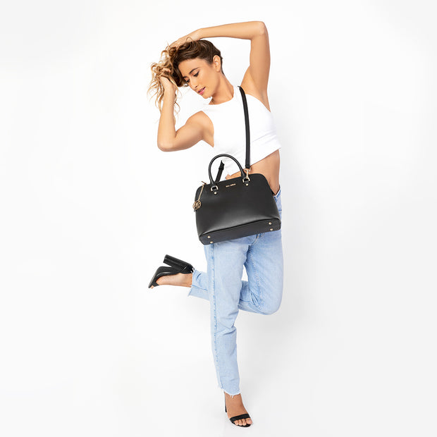 Eila Cherie Barbara Black Leather Fashion Handbag worn by dancing girl with white crop top and denim jeans