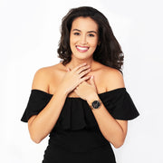 Eila Cherie womens Emilia black Marble fashion watch rosegold worn by smiling woman in black dress