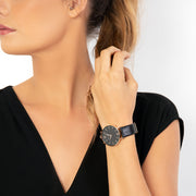 Eila Cherie womens black leather watch worn on the wrist of an attractive woman