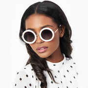 Eila Cherie White Round Sunglasses on attractive woman wearing a pocadot dress