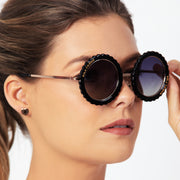 Eila Chérie Black round polarized sunglasses on woman smiling