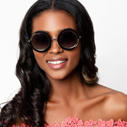 Eila Chérie Black round sunglasses on woman smiling