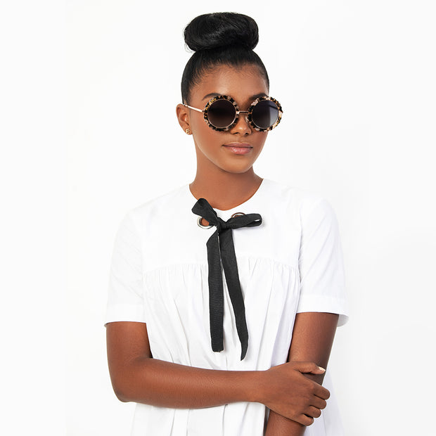 Eila Cherie mimi white tortoise sunglasses on stylish woman with high bun