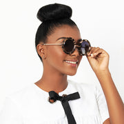 Eila Cherie side view of mimi white tortoise sunglasses on stylish woman with high bun