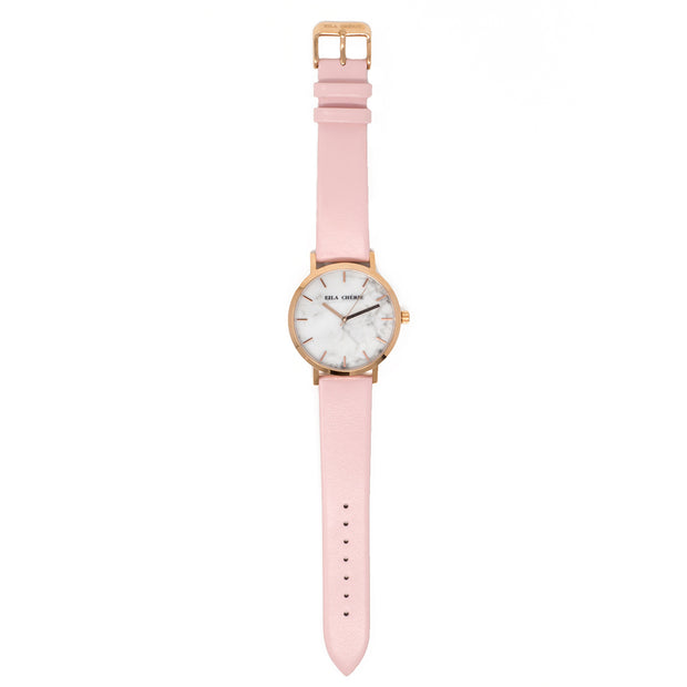 Flat lay of Eila Chérie Marble womens watch Olivia with petal pink colored leather strap