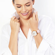 Eila Chérie Marble womens watch Olivia with petal pink colored leather strap on the wrist of an attractive woman wearing a white shirt