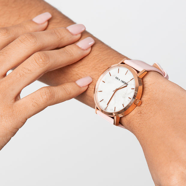 Eila Chérie Marble womens watch Olivia with petal pink colored leather strap on the wrist of a woman with pink nails