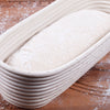 Image of Premium Long Oval Banneton Basket with Liner - Perfect Oblong Brotform Proofing Basket for Making Beautiful Bread