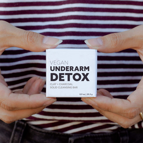 Small White Box Labeled: Vegan Underarm Detox. Clay + Charcoal Solid Cleansing Bar