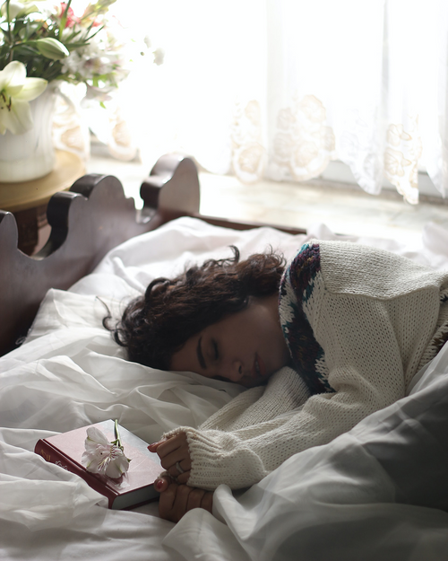 Women taking a nap in bed
