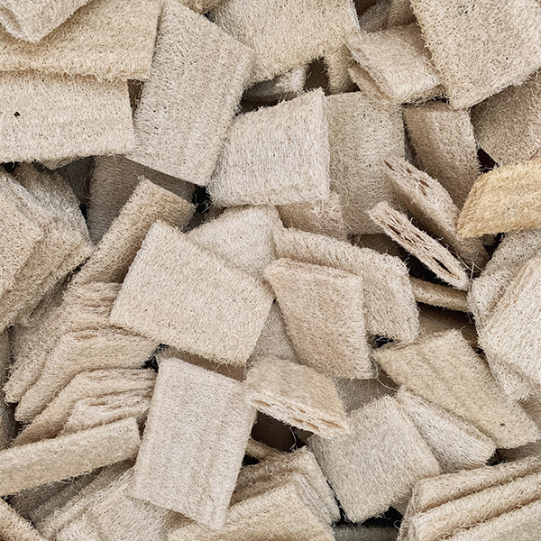 A detail of a pile of natural loofah scrubbers