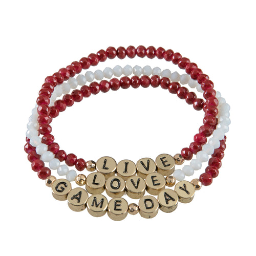 "Set of 3 maroon and white beaded stretch bracelets with gold beads that say ""live, laugh, gameday."""