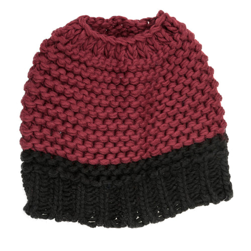 Maroon and black knitted bun hat.