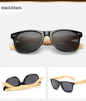 Rectangle sunglasses with bamboo wood arms. Black lens, black frame around lens