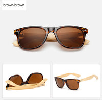 Rectangle sunglasses with bamboo wood arms. Brown lens, tortoise shell frame around lens