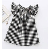 Girls black and white gingham plaid dress with ruffle sleeve.