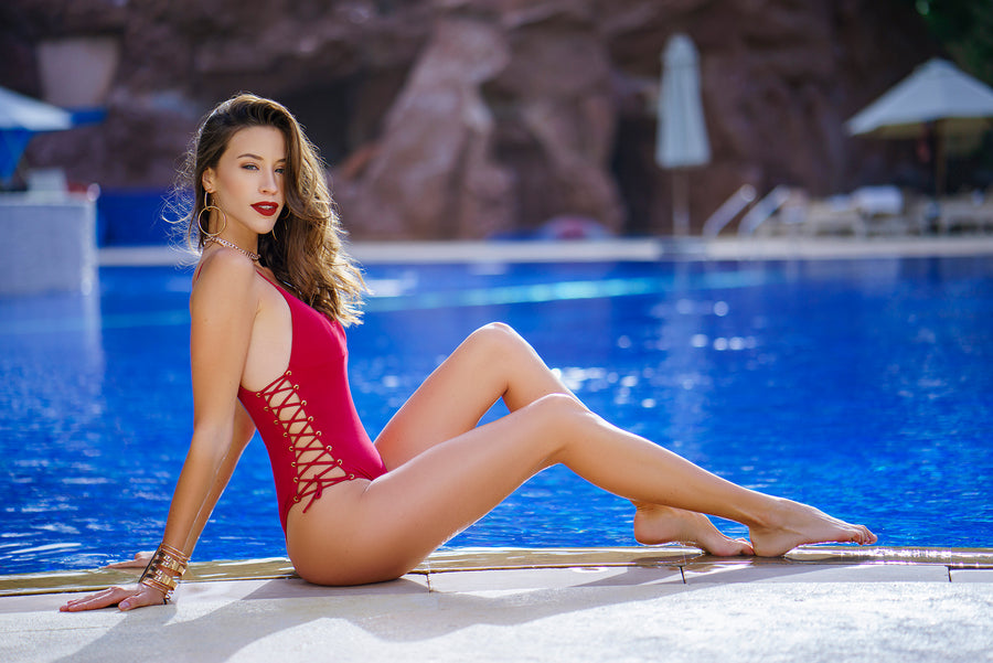 Red swimsuit next to pool