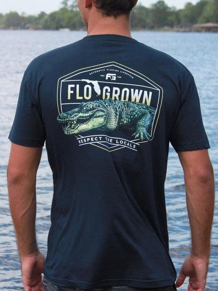 FloGrown FGM-1296 Mens Short Sleeve Local Gators Tee Navy with a man FGM1296