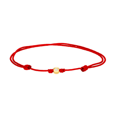 Gold Ball With Diamond Trillion On Cord Bracelet