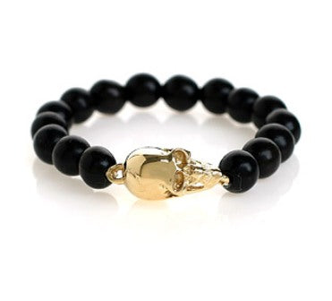 LARGE GOLD SKULL BRACELET ON EBONY BEADS