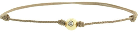 YELLOW GOLD BALL WITH DIAMOND ON A CORD BRACELET