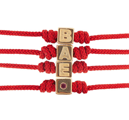 GOLD BAE CUBE WITH RUBY CORD BRACELET