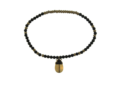 Gold Enameled Scarab On Beaded Bracelet