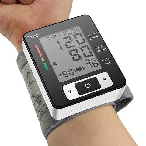 Person using portable blood pressure monitor on their wrist