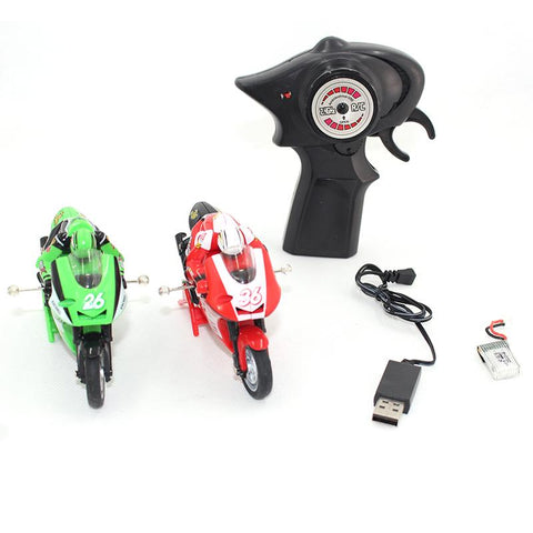 two radio controlled motorcycles with controller and charging cable