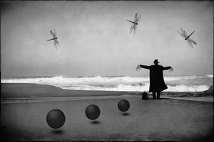 Man in Black With Spheres