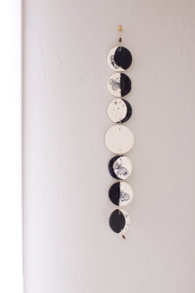 ceramic moon phases wall hanging