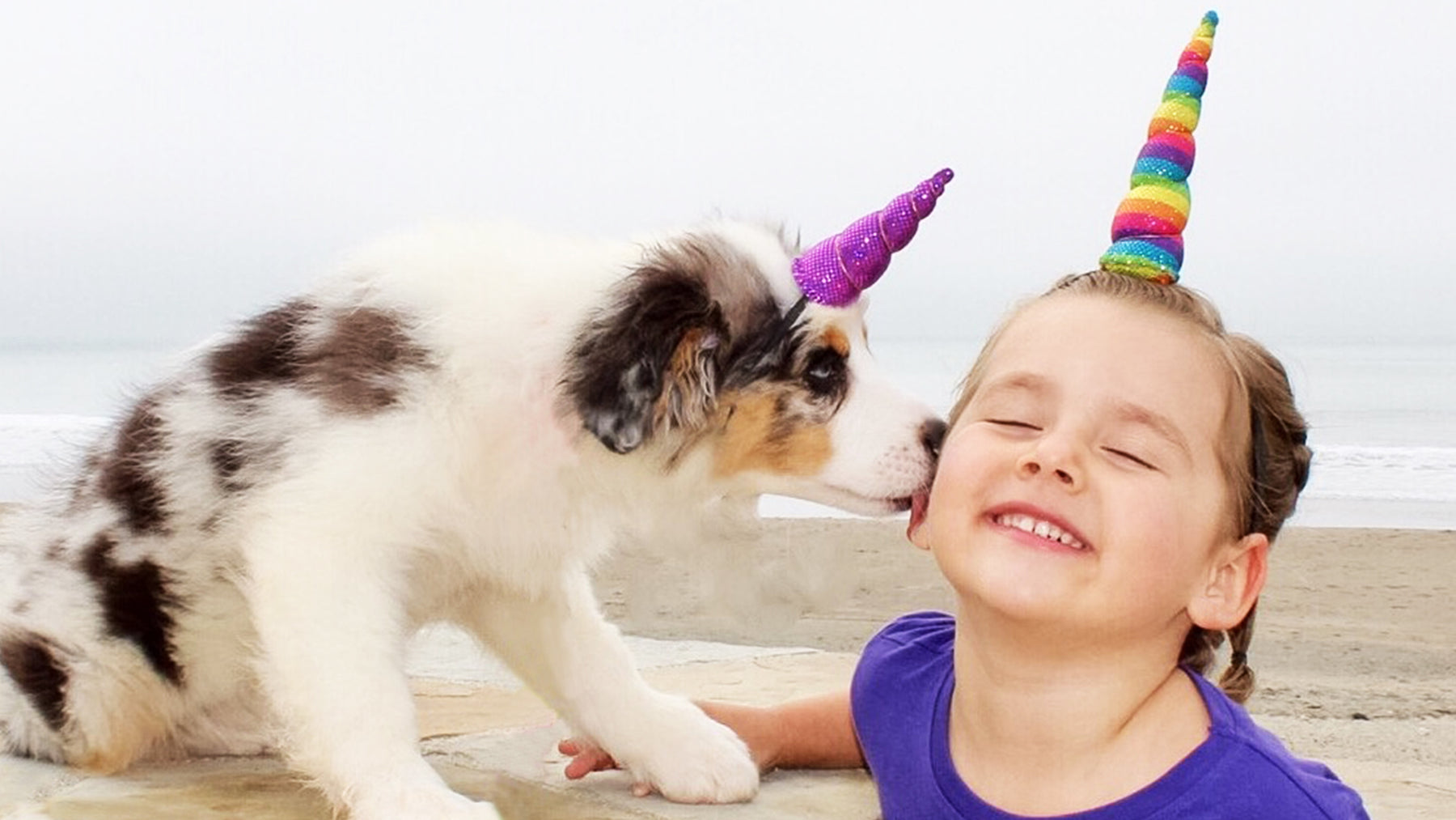 Unicorn horn on girl and puppy