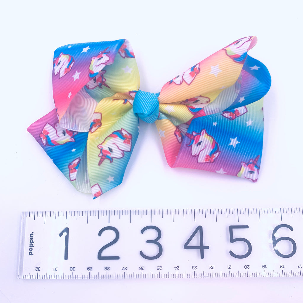 Rainbow Unicorn Hair Bow with pink and white unicorn