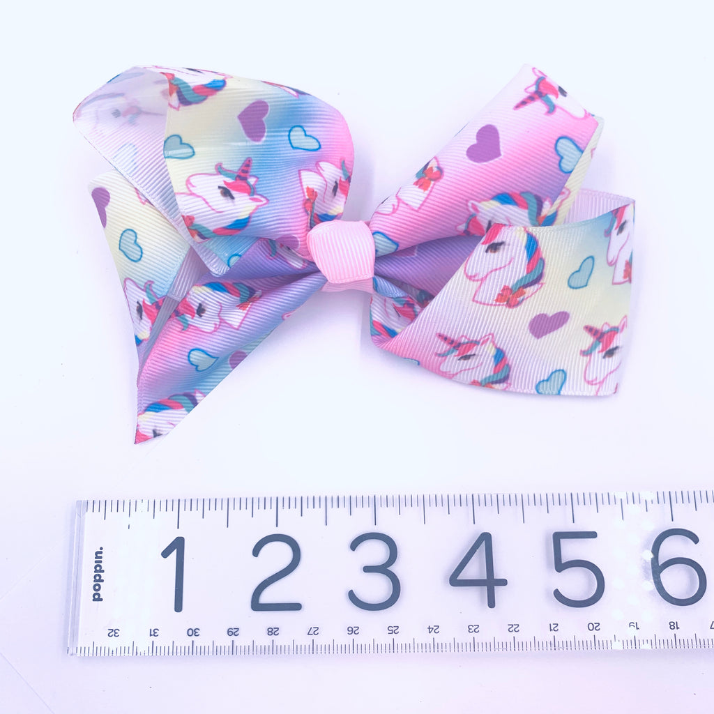 Pastel Hair Bow with pink and white unicorn