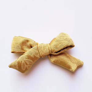 Vintage bright gold Elloise bow