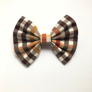 3 inch fall brown orange plaid bow. orange center