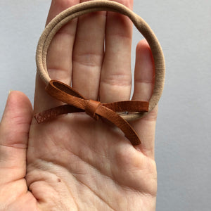 Genuine leather tiny tied bow