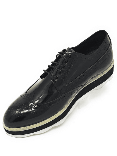 BLACK WINGTIP CREEPERS,Classic wingtip created for comfort and style. Leather upper, leather inside lining, cushion sole, lace-up construction, rubber platform sole, and light weight.