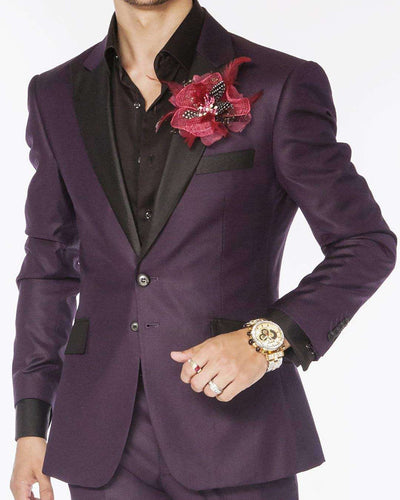 purple solid slim fit tuxedo suits with black peak lapel and flap pockets
