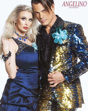 guy is wearing a  sequins suits gold blue and silver, girl next to him wearing a blue dress