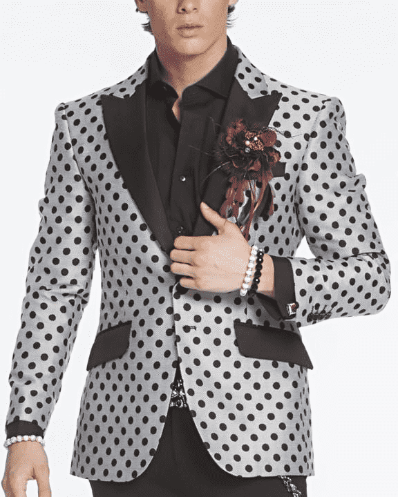 Black and white polka dot blazer with black lapel pick lapel and pocket flaps.