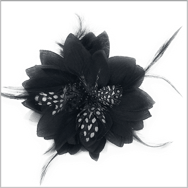 black hand made lapel flower