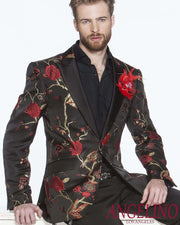 guy in a black blazer with red flower and gold tree motifs