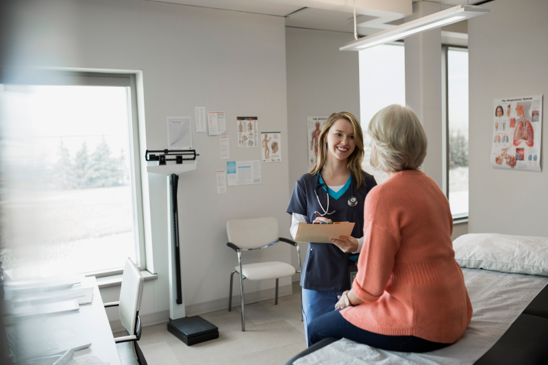 Client receiving ostomy consultation in health care setting